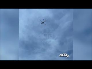 Спасатели и вертолёт тушат лесной пожар в Корсаковском районе