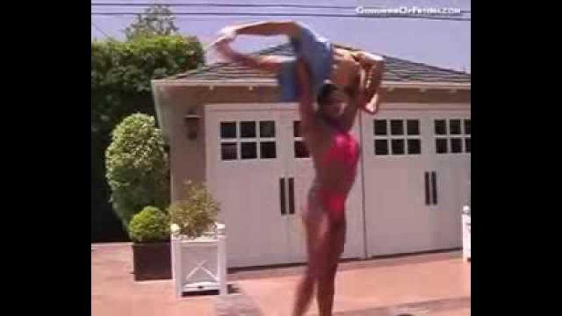 Amber DeLuca lifting a man overhead