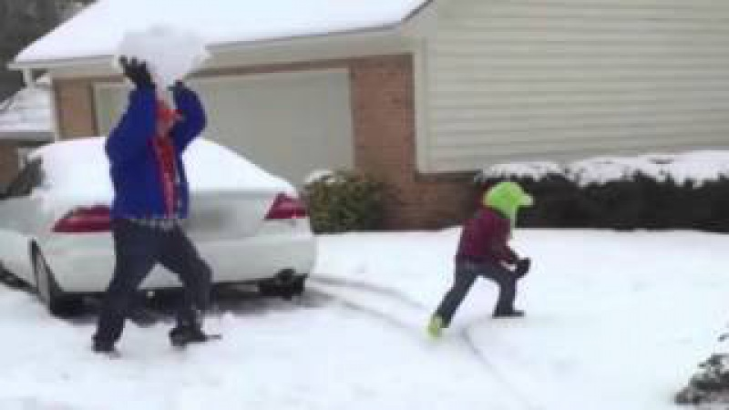 Dad Throws Giant Snowball at Kid
