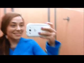 Girl pisses on clothes in shop