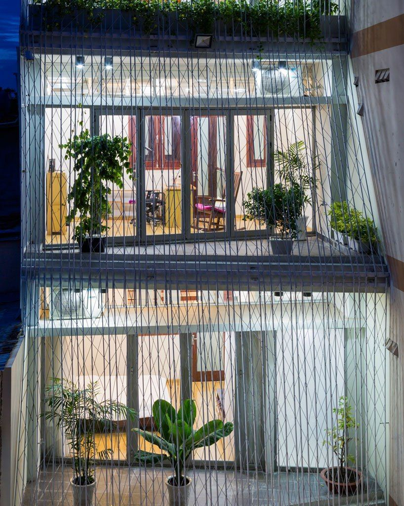 mel schenck envelops breeze house's façade with lattice screens in vietnam
