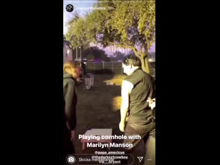 Marilyn Manson is playing cornhole at Aftershock