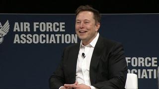 Elon Musk and Lt Gen John F. Thompson