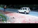 Biker Saved at Last Second by SUV as Digger Speeds Towards Him