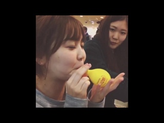 Asian girls have fun playing with balloons in various ways